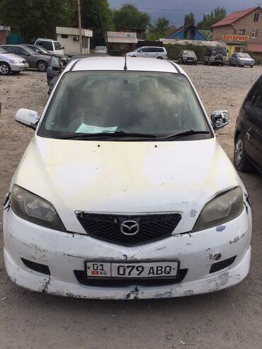 Mazda Demio 1.3 л. 2004