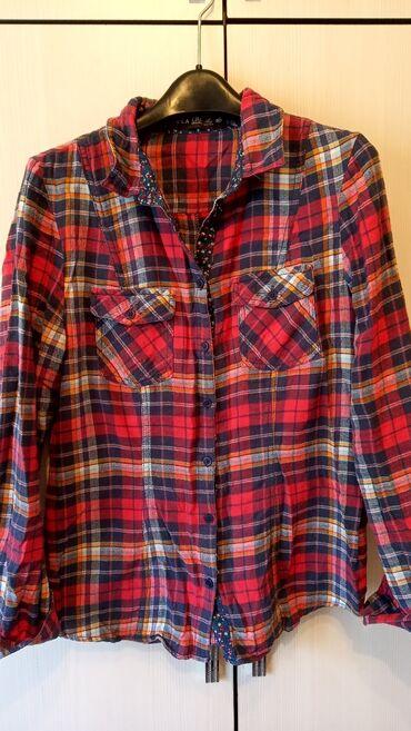 Продаю женскую рубашку состояние хорошее.размер 46