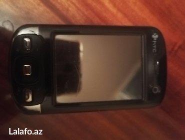 """Мобильный телефон , """" htc """". продаётся как в Bakı"""