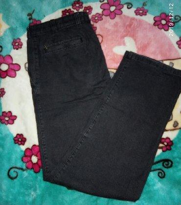 Мужские брюки(джинс) Черного цвета. Талия в половине 46. Бедра в полов