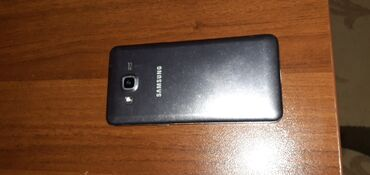 Samsung - Saray: Samsung-SM-G531H Tam islek veziyyetdedir.Batereya saxlayir.2 ildir