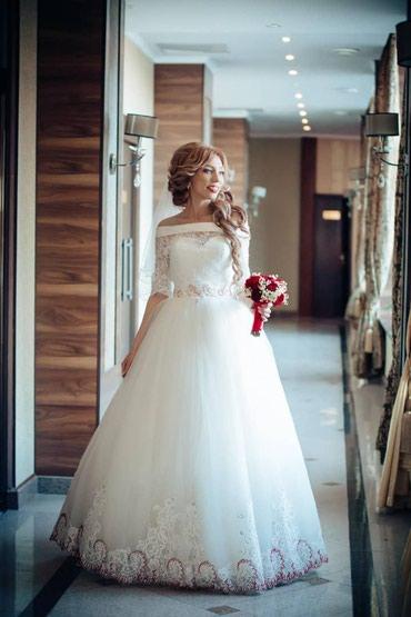 Шикарное свадебное платье расшитое в ручную прошу 100 USD