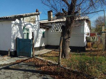 продаю две половины дома. (дом разделен на 4 хозяина) село кордай. нед в Бишкек
