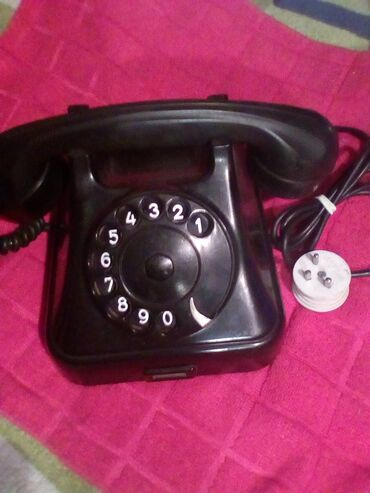 Klasicni telefon/bakelitni/ispravan sa porcelanskom viljuskom