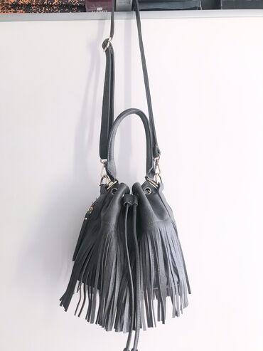 Круглая сумка с бахромой. Очень удобная и легкая! Красиво подходит к