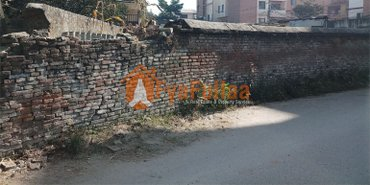 land having area 0-9-0-0, 13 feet pitched road, facing south-west is in Kathmandu