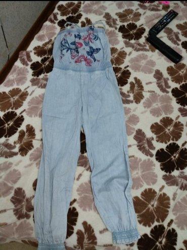Детский комбинезон, джинсы. На возраст от 6-8 лет, ростовка 128 см