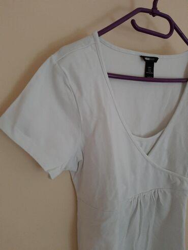 H & M mama majica bela. Vel L. Sa elastinom