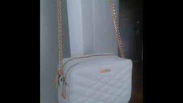 Bolero-bela-bundica - Srbija: Bela carpisa torbica,nova,za sve prilike, dimenzije 21cm duzina, 10