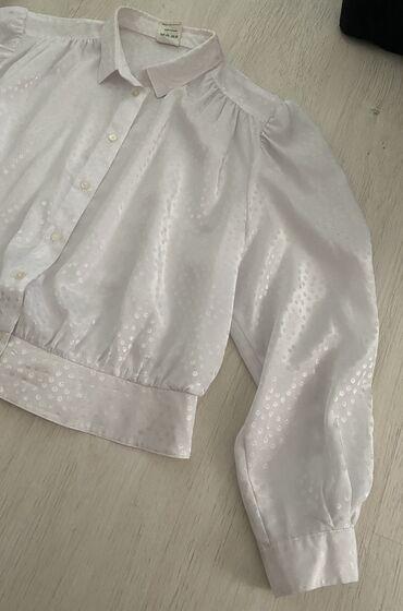 Bela kosulja sa - Srbija: Bela kosulja sa blagom puf rukavima, kraci model. Velicina na etiketi