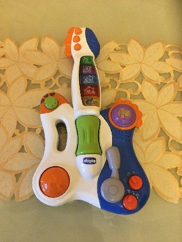 Продаю музыкальную гитару Chicco. Состояние отличное