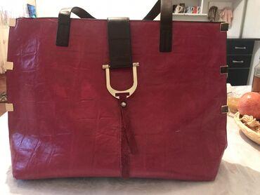 Женская вместительная сумка розового цвета