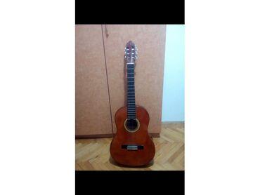 Gitare | Srbija: Prodajem akusticnu gitaru Valencia gitara malo koriscena u dobrom