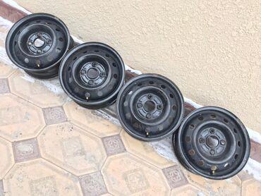 шины 18570 r14 в Кыргызстан: Продаю оригинал штампы диски на хонду торнео с калпаками тоже оригина