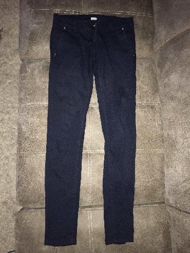 Cna-broju - Srbija: Pantalone u broju 26. Teget boje