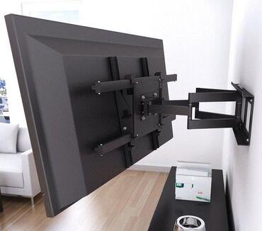 Установка телевизора на стену. Повесить телевизор на кронштейн ровно