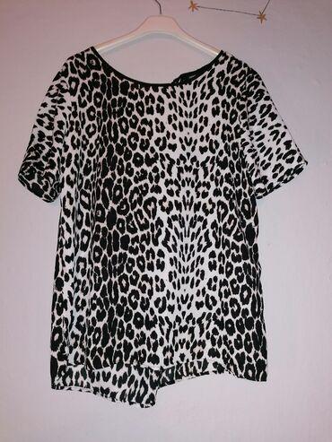 Tigrasta majica, prijatnog materijala, nkad nosena, kupljena u