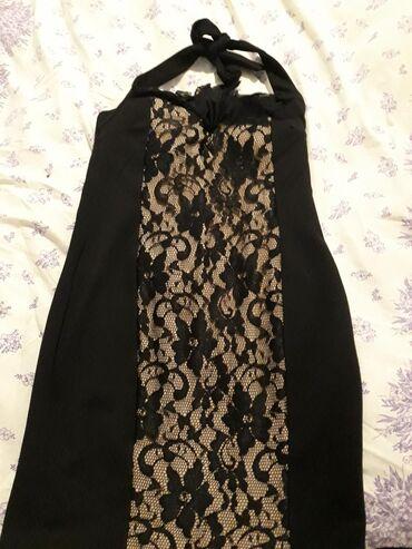 Crna haljinica sa cipkastim delom jednom pbucena l,xl velicina 500din