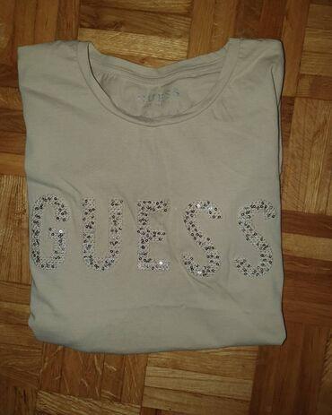 Prolecna bez oko - Srbija: Guess original majica s velicine
