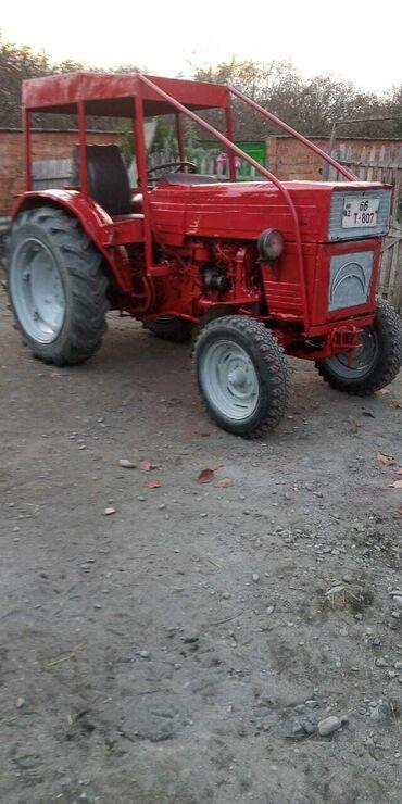 Kənd təsərrüfatı maşınları - Zaqatala: Universal traktör süper vezyetde mator yağ yemir üstünde kasilka ve