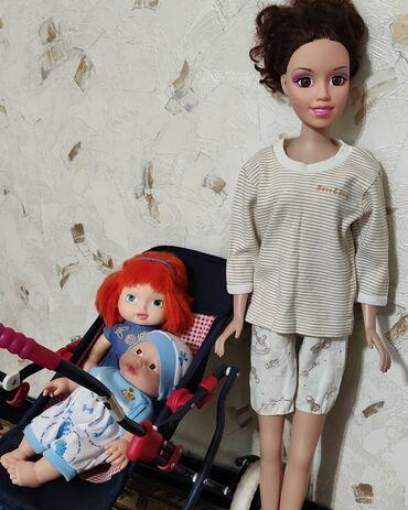 Продам игрушки:Высокая кукла б/у высота 75 смРыжая кукла б/у высота