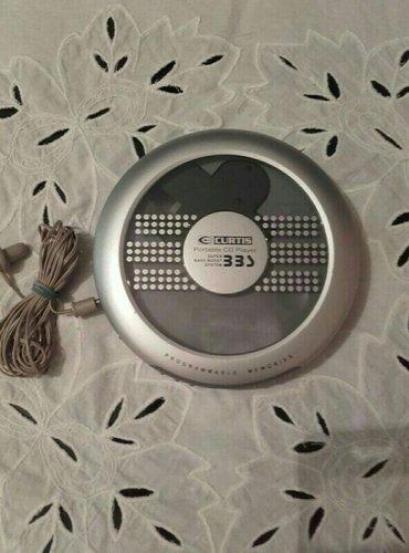 CD  PLAYER Curtis portable , potpuno novo, nekorisceno. - Beograd