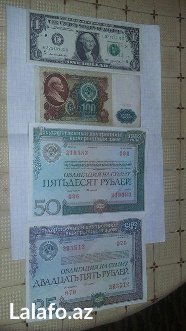 Bakı şəhərində SSSR-nin ve ABŞ-nin pullari Hamisi bir yerde