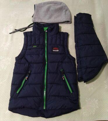 Отличного качества и состояния,деми курточка(+безрукавка) на мальчика