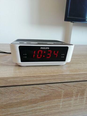 Philips xenium x128 - Srbija: Radio budilnik Philips. Dimenzije visina 5 cm, širina 13cm, dubina
