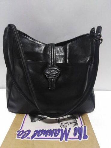 Boja: crna Materijal: Koža Proizvođač: Manual Nošenje: Preko ramena Vr