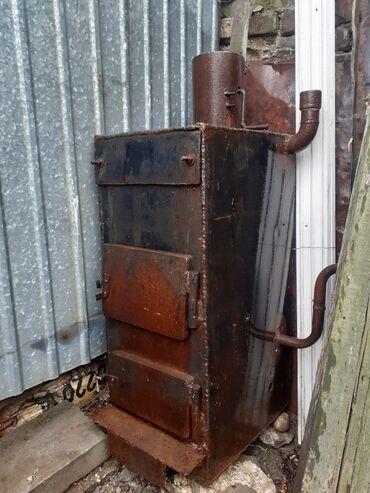 Отопительный котёл на твердом топливе на газе и на электричестве . с в