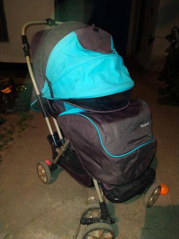 Good baby коляскаРучка перекидывается. Вместительная корзина.Козырек
