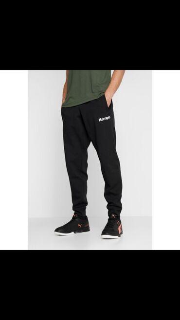 Мужской спортивный брюки быстро и качественно. Только оптом
