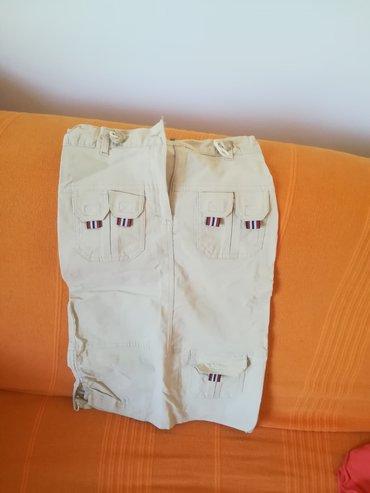 Kvalitetna suknja bež boje sa džepovima za toplije dane, vel 6, obim