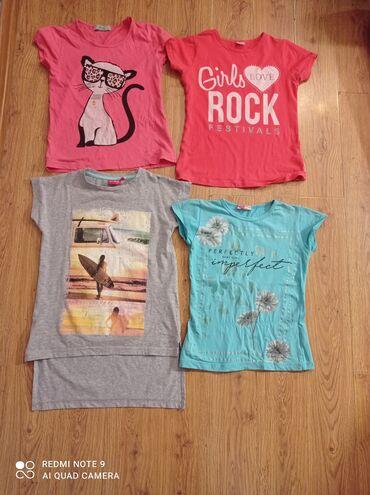 Находки, отдам даром - Кыргызстан: Отдам 4 футболки за большой сникерс. Футболки х\б на девочку 8-10 лет