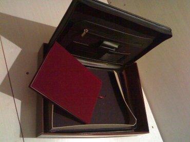 зажимы для денег в Азербайджан: Отличный памятный подарок. Офисная папка,очень солидный подарок для