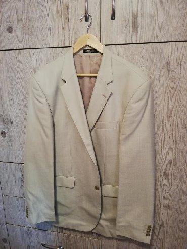 Πωλείται κοστούμι XL στο χρώμα της άμμου δύο φορές χρησιμοποιημένο!