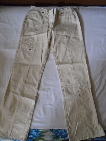 Pantalone cm - Srbija: TCM bež pantalone, etiketa sa raznim evropskim veličinama je slikana a