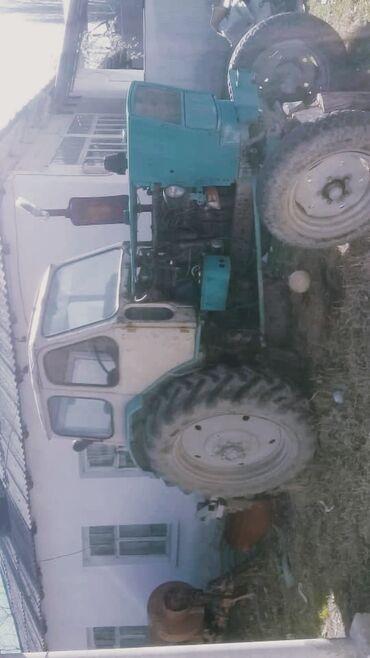 Юмз трактор абалы жакшы жана шаймандары менен прессподборшик киргизст