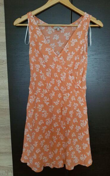 Haljine | Negotin: Narandzasta haljina sa postavom vel.38, struk 33cm, grudi 35cm, duzina