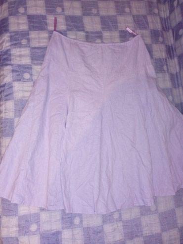 Lepršava suknja sa postavom i sa dubljim strukom. Boja je nežno - Belgrade