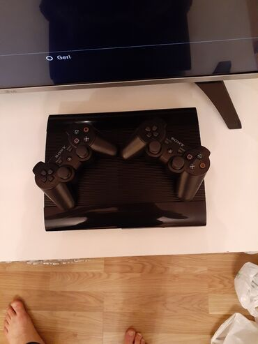 Playstation 3 Super Slim 500 gb yaddasli. Yaddasinda hazir yazilmis