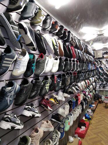 Реализатор керек обувь сатканы рынок дордой