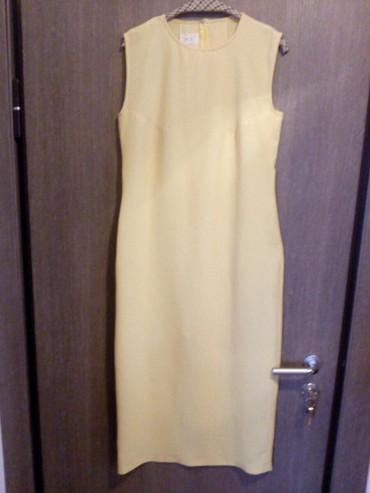 Duga leprsava haljina - Crvenka: Haljina dugacka zuta od punijeg letnjeg zorzeta. Kroj prati liniju