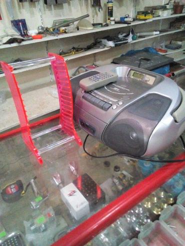 Bakı şəhərində Super veziyyetde maqnitafon Panasonik. hem disk, kasset ve radio.