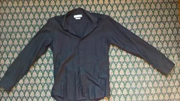 Evropska-usa - Srbija: MARSHAL košuljaNekorišćena košulja. Na MARSHAL sajtu cena je 4 000