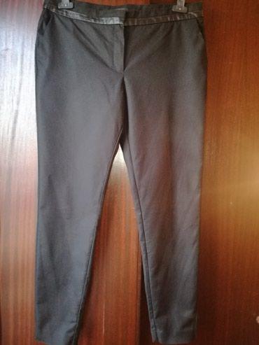 Crne pantalone sa dzepovima - Srbija: Mango elegantne pantalone sa kosim dzepovima,dole