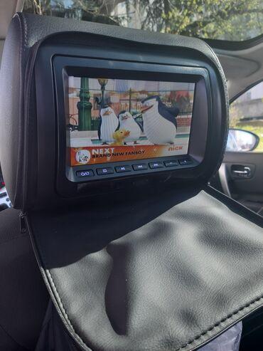 Vozila - Srbija: Auto DVD u naslonu sedista. U odlicnom stanju sa daljinskim