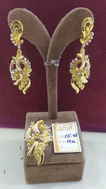 585 prob qızıl dəsti satılır. Dəstə üzük və sırğa aiddi. 15.45 K