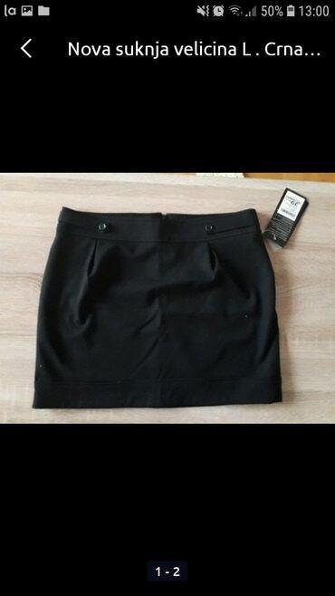 Nova crna suknja  Velicina L